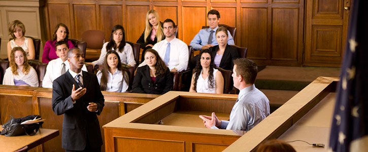 A student examining a witness in the moot court