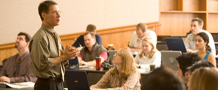 A professor lecturing to a class