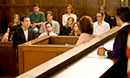 Students engaging in a mock trial in the Moot Court room
