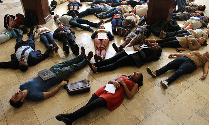 Students, faculty and staff participate in die-in