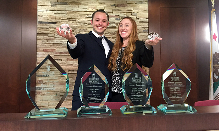 2L Matthew W. Hobson and 3L Joanne L. Heilbrun with their six awards