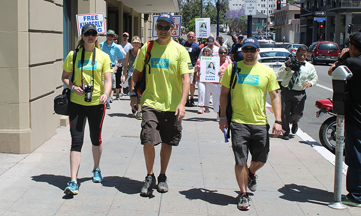 California Innocence Project Lawyers Alissa Bjerkhoel '08, Justin Brooks, and Michael Semanchik '10 begin the march from California Western to Ocean Beach