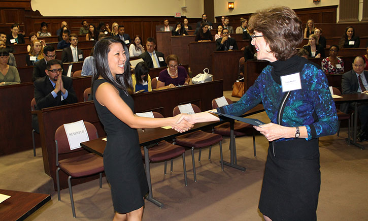 3L Athena Hwang Receives her certificate from Associate Dean Linda Morton