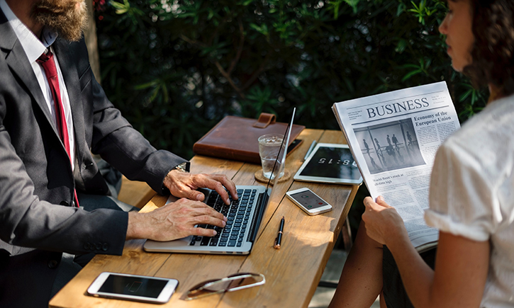 Man and woman in business setting
