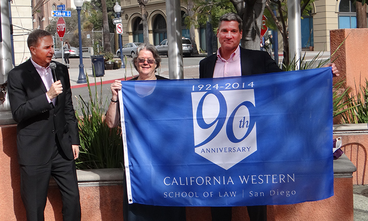 President and Dean Niels B. Schaumann (left) at the raising of the 90th anniversary flag