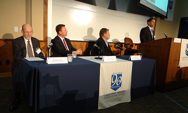 Panelists at the inaugural Air & Space Law Symposium as William Janicki of Morrison & Foerster presents