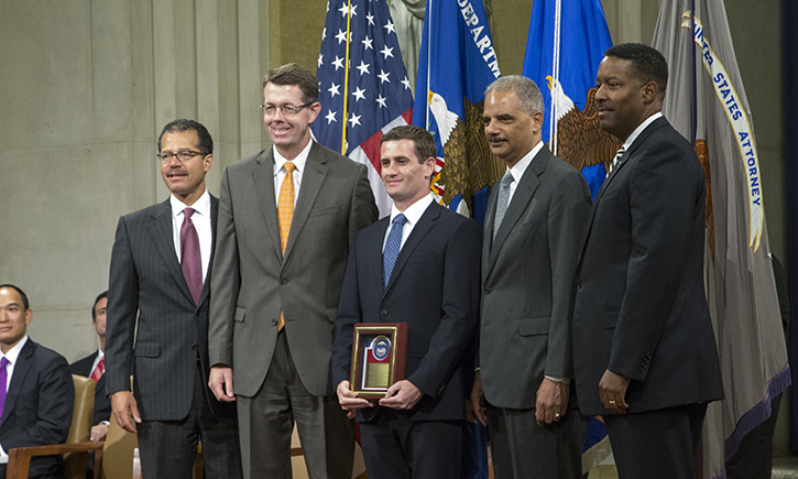 David P. Finn '06 (Center) with Attorney General Eric Holder (Second from Right) in Washington, D.C.
