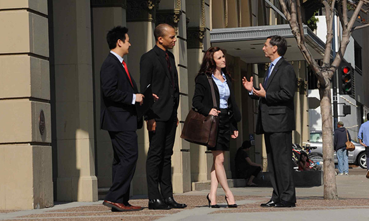 Dean Smith (right) chats with California Western students and staff