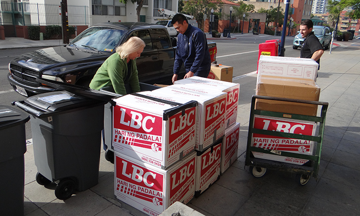 From left: Pam Tait, Edward Pamintuan and Trevor Young load typhoon supplies collected during California Western's emergency relief drive