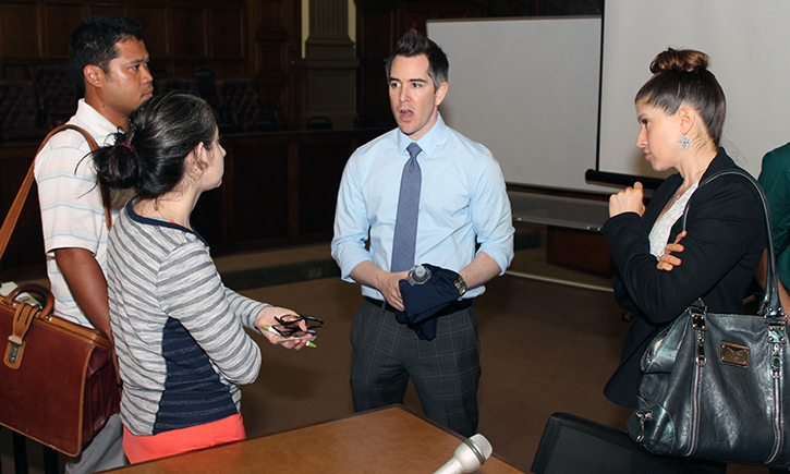 Students network with panelists Bryce Besser '04 (C) and Kristen Knepper (R)