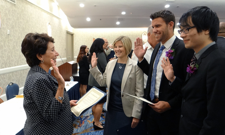 Hon. Irma E. Gonzalez (Ret.) administers the Oath of Professional Conduct to California Western graduates Carrie L. Petersen, Sean M. Jones, and Sam Yang