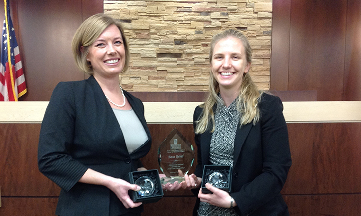 Third-year students Rachel M. Ferguson and Susan M. Sindelar hold the National Juvenile Law Competition first place trophy