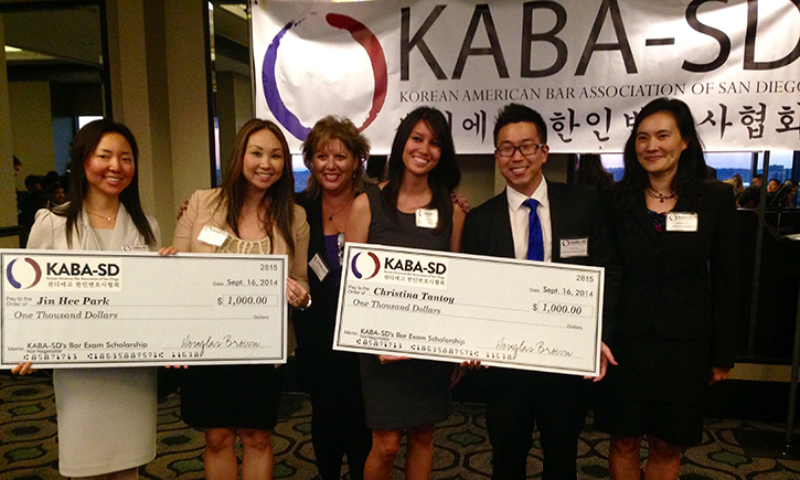 Jin Hee Park (L) and Christina Tantoy (C) receive their KABA scholarship awards