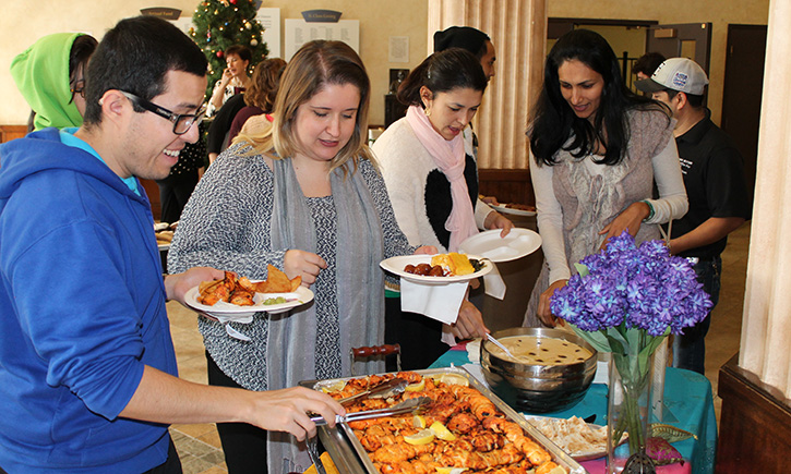Students and Staff Enjoying the Multicultural Feast of Foods