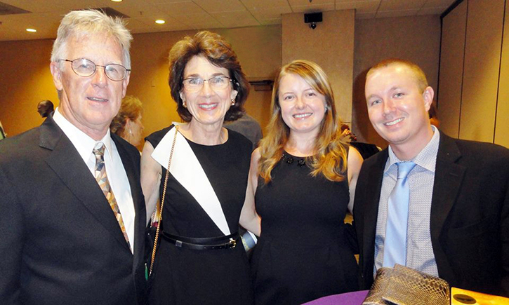 California Western Associate Dean Linda Morton (second from left) and husband Leonard Bole (left), with Eva Lautemann '09, Drew Lautemann '09