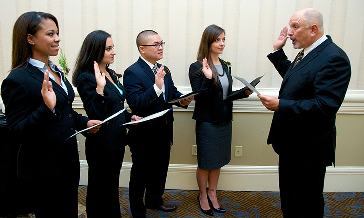 The Hon. Anthony J. Battaglia '74 administers the Oath of Professional Conduct to California Western graduates Nicole D. Allen, Shana J. Metzger, Kenny Nguyen, and Christina A. Shourds