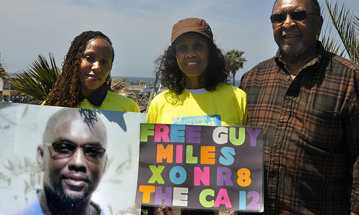 Family of Guy Miles with sign that reads 'Free Guy Miles'